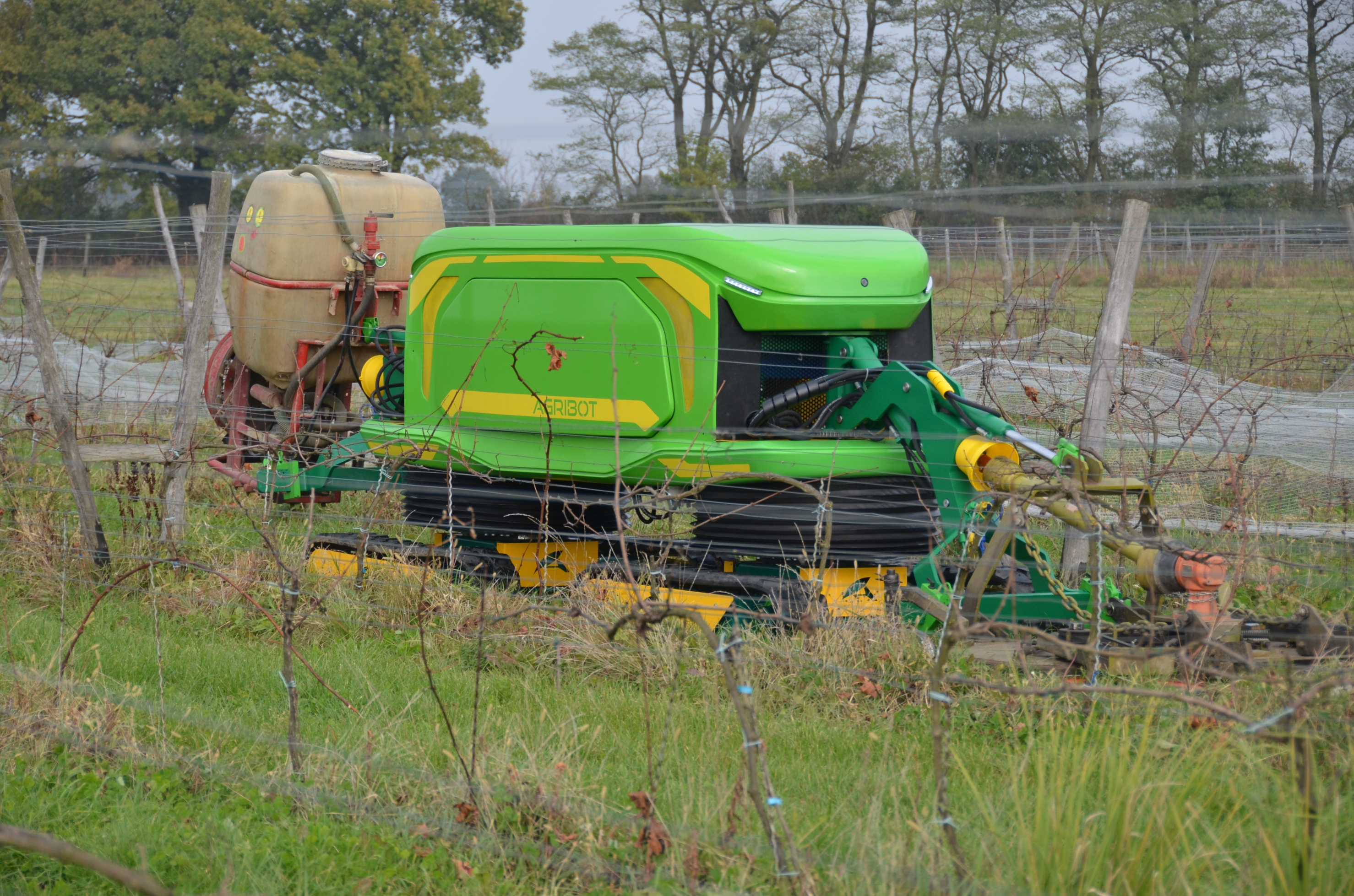 Agribot is a robot, that autonomously does all the work in orchards and plantations. It is controlled via the operator panel accesible through a web browser. Here, it can be seen during one of the first field tests in a vineyard, where ist capabilities to operate two machines at once was tested. (Image credit: Agribot sp. z o.o)