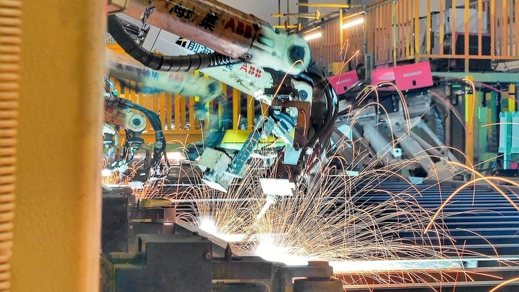 Welding production line where ABB robots are performing welding tasks © ABB