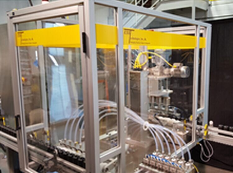 The Flexible Filler/Capper is designed to use a circular puck conveyor system to transport vials or small bottles to the inline filling system. © FANUC America