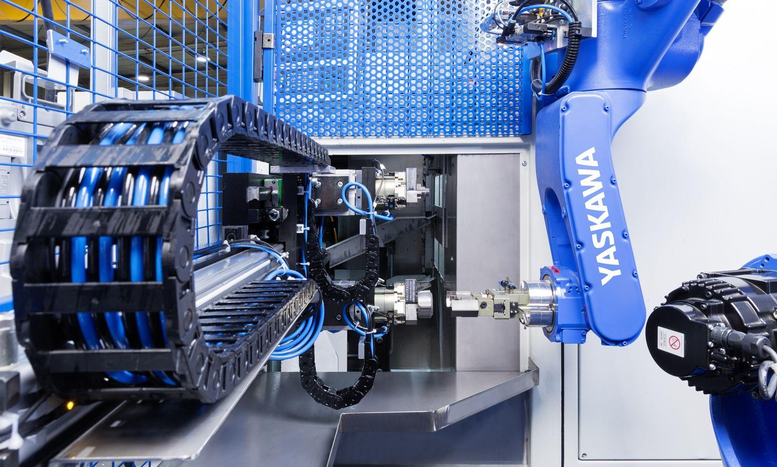 Four Yaskawa Motoman handling robots feed two turning